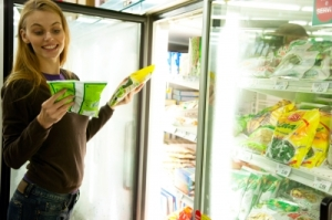 woman reading label on supermarket item