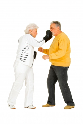 Old woman punching old man