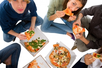 Youngsters eating junk food